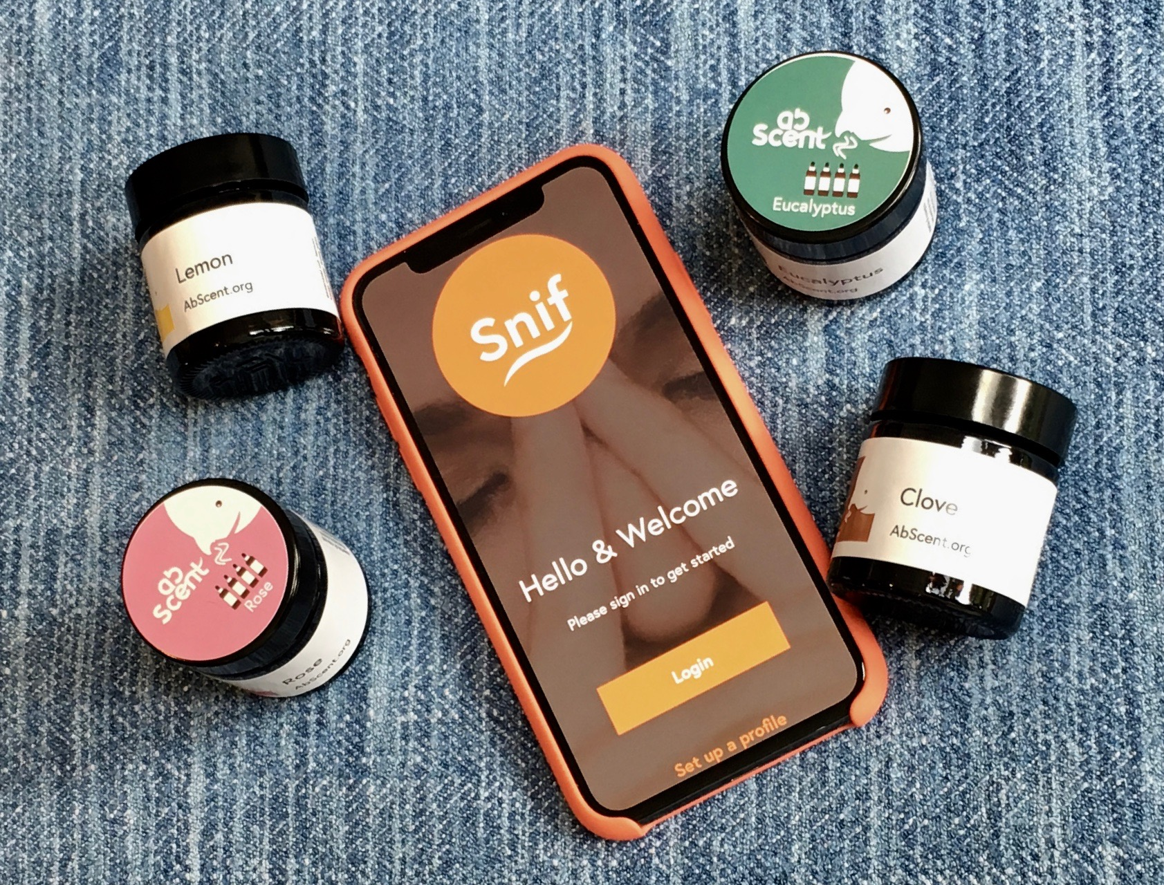 Sniff App on mobile phone next to smell training jars