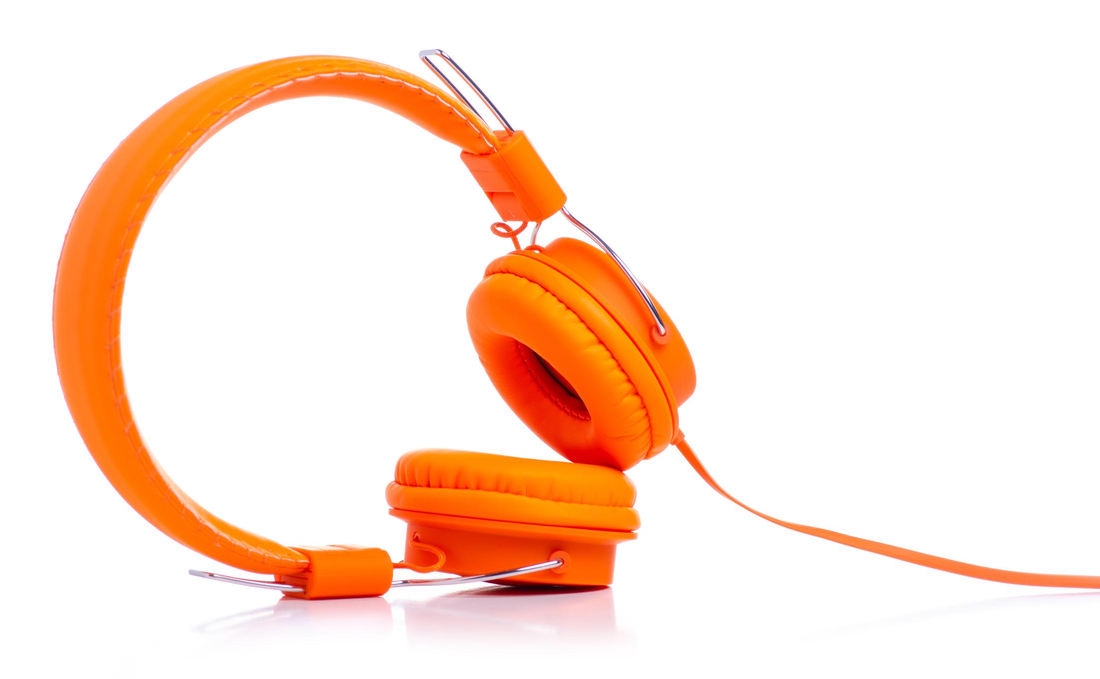 Compelling content with orange headphones - radio